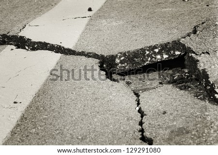 cracked asphalt after earthquake - stock photo