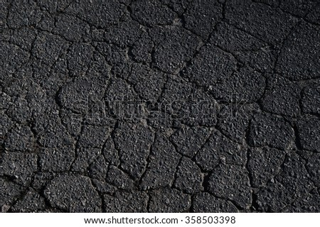 cracked asphalt road surface texture - stock photo