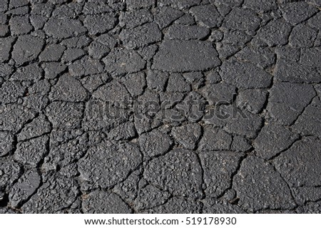 cracked asphalt road surface texture