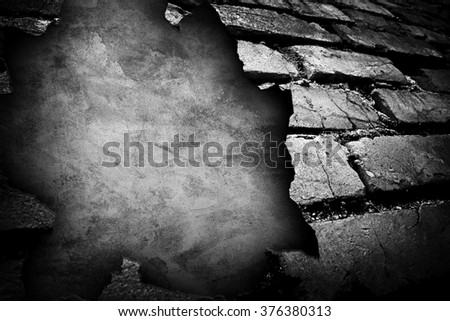 cracked brick wall with large hole background