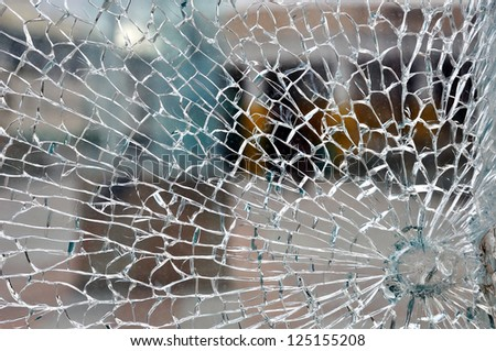 Cracked broken destroyed glass damaged window background - stock photo