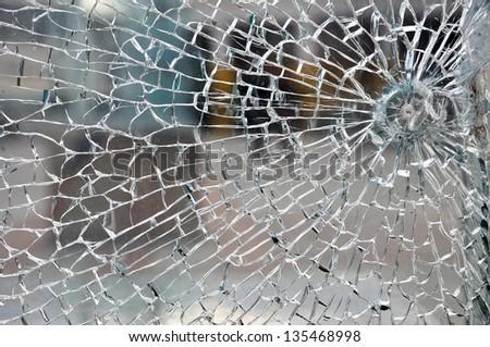 Cracked broken destroyed glass damaged window background - stock photo