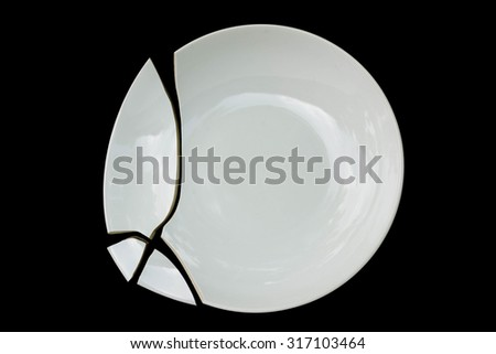 cracked ceramic plate on black background