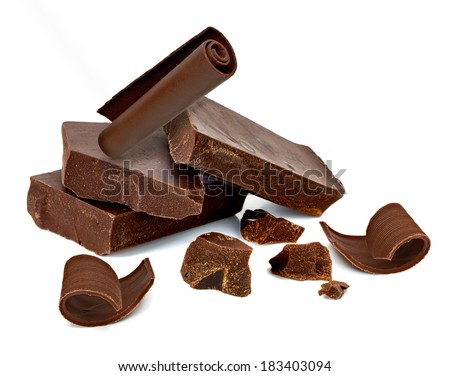Cracked chocolate blocks with curl on white background - stock photo