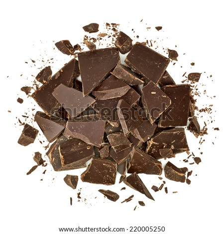 Cracked chocolate pile top view on white background - stock photo