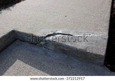 cracked concrete cement step sidewalk