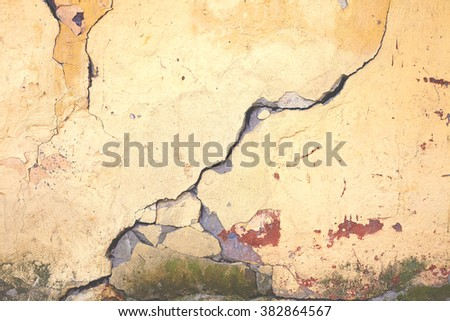 Cracked concrete texture closeup vintage background yellow color