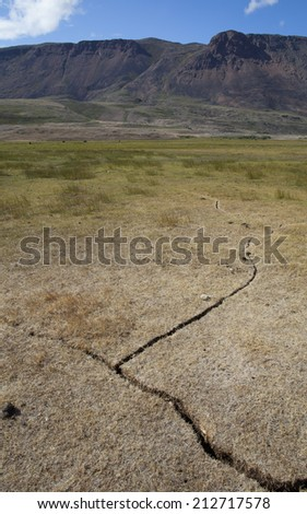Cracked earth after drought in arctic tundra, Greenland - stock photo