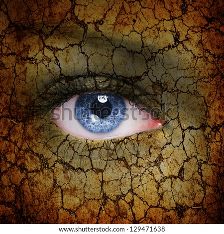 Cracked earth pattern on woman face - stock photo