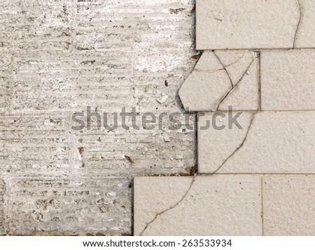 Cracked floor tiles - stock photo