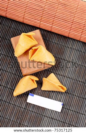 Cracked Fortune Cookies with Blank Fortune Paper - stock photo
