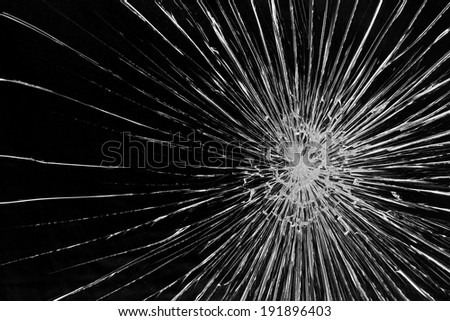 Cracked glass against a black background