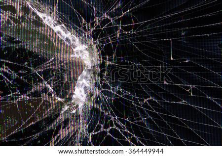 Cracked glass of broken lcd TV display screen - stock photo