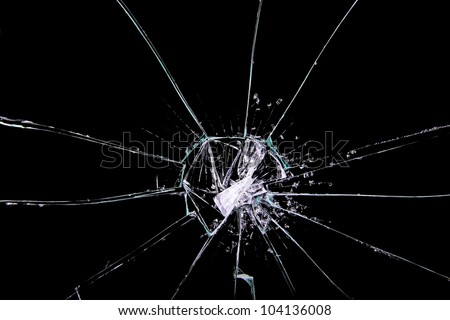 cracked glass on black - stock photo