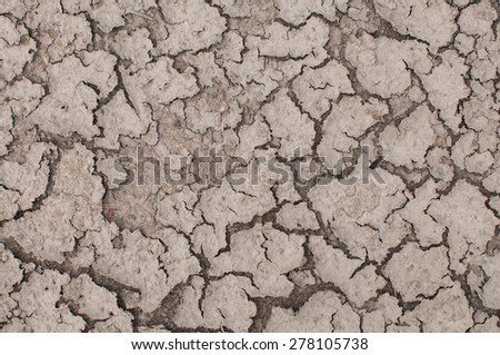 cracked ground, background texture. - stock photo