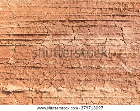 Cracked ground texture with wheel track background