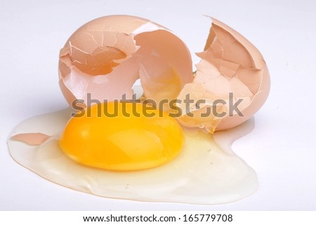 Cracked hen's egg food with yolk and albumem - stock photo