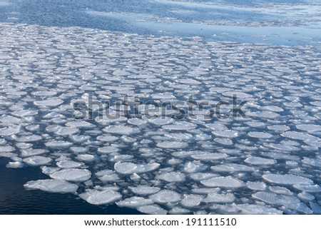 cracked ice on river in spring time - stock photo