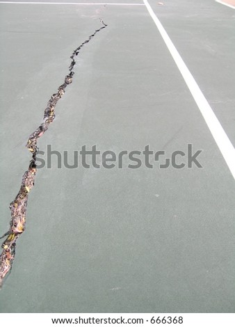 Cracked line in a tennis court - stock photo