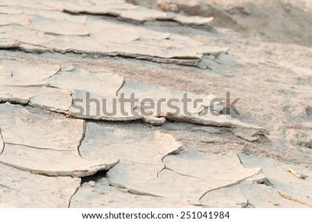 Cracked of mud texture during summer along Mekong river, natural border between Thailand and Laos.  - stock photo