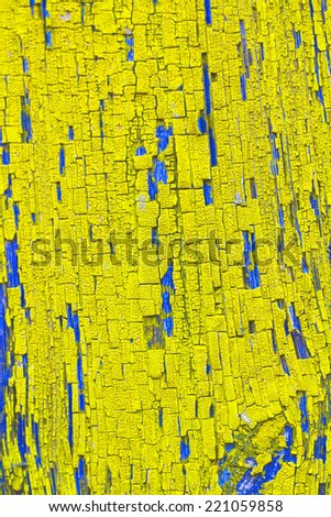 Cracked old yellow paint.Background - stock photo