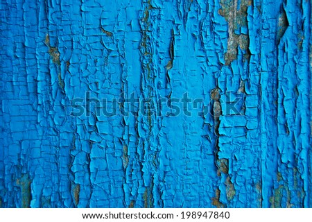Cracked paint on a wooden wall. Wall from wooden planks with paint traces. old painted wood wall texture, grunge background, cracked paint. - stock photo