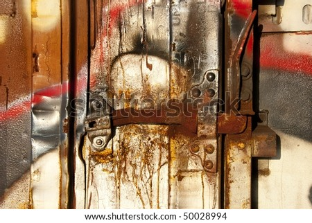 Cracked paint on rusty box car in railroad yard - stock photo