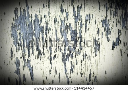 cracked paint on wooden board