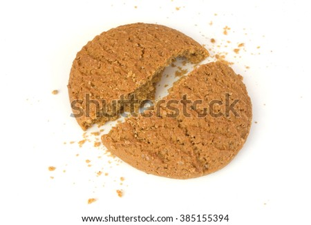 Cracked pieces of oatmeal cookie - stock photo