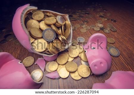 cracked pink pig moneybox closeup - stock photo