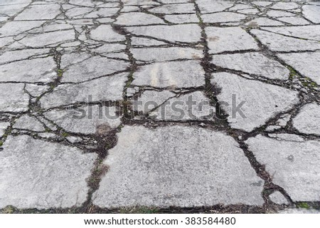 Cracked road as a grunge background - stock photo