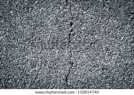Cracked small granite stonewall background - stock photo