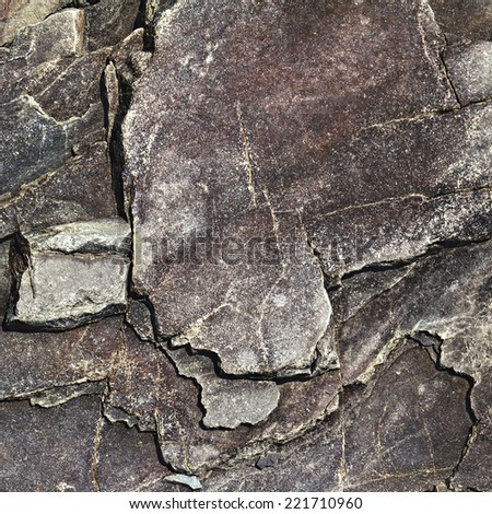 cracked stone rock in the style of grunge as background - stock photo