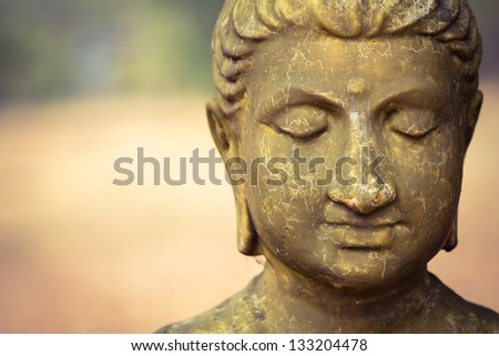 Cracked surface of old Buddha statue, decline of Buddhism concept - stock photo