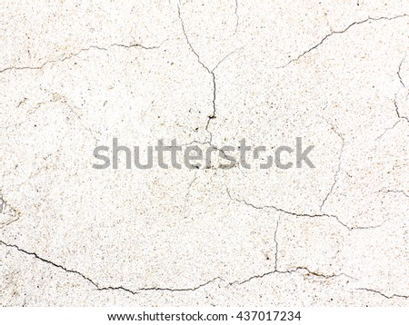 Cracked surface of rough plaster - fine cracks and scratches on the plaster