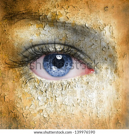 Cracked surface on woman face. Symbol of dry skin. - stock photo
