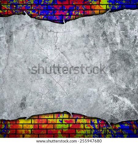 cracked wall with graffiti brick - stock photo