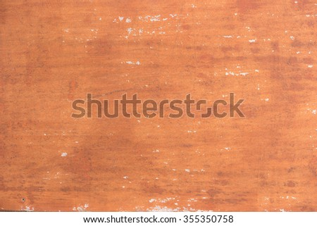 Cracked weathered brown painted wooden board texture. - stock photo