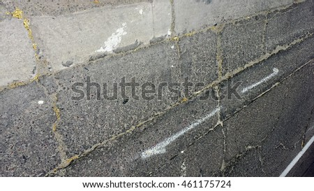 Cracked weathered grey asphalt wall background with perspective lines