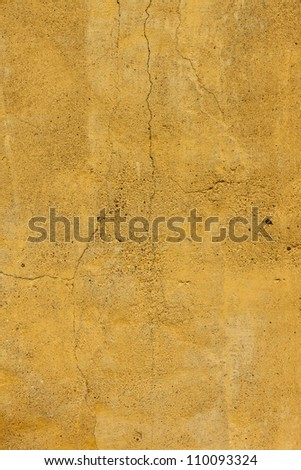 Cracked Yellow concrete wall texture - stock photo