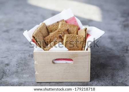 Cracker in box wooden on cement. - stock photo