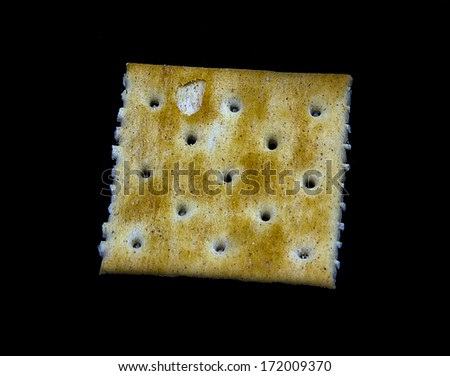 Cracker isolated on a black background - stock photo