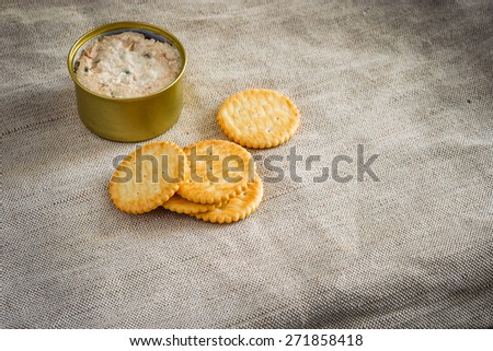 Cracker with tuna spread topping