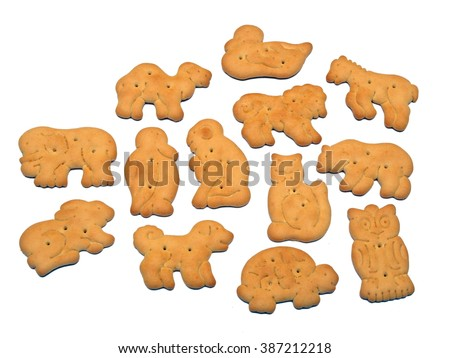 Crackers baked in different shapes as birds and animals on white background.