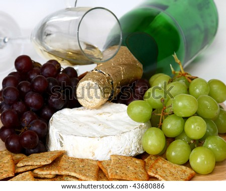 crackers, grapes, cheese and wine