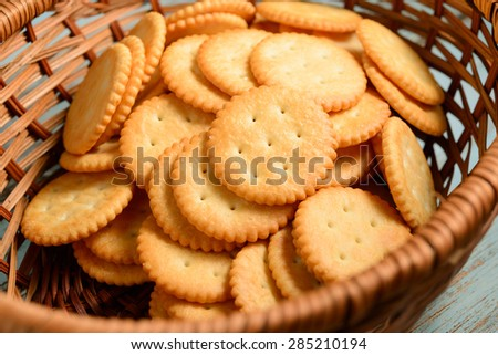 Crackers in wooden basket - stock photo