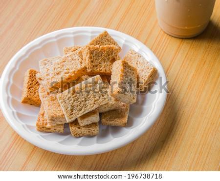 Crackers on plastic plate - stock photo