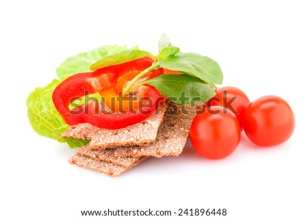 Crackers with fresh vegetables isolated on white background. - stock photo