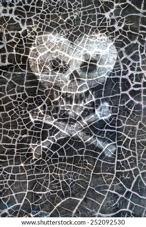 Crackled wall plaster texture, heart in the form of a skull and  - stock photo