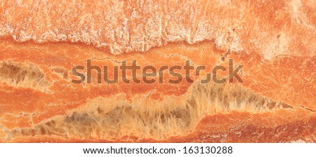 Crackling white bread. Close up. Whole background. - stock photo